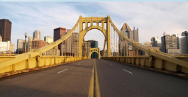 A photo of one of Pittsburgh's yellow bridges.